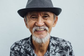Cool senior asian man smiling looking at camera