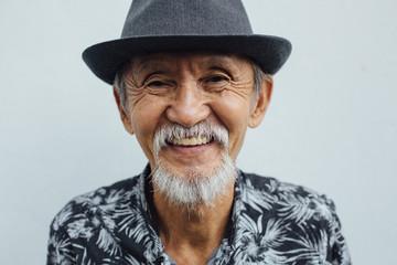 Cool senior asian man smiling looking at camera