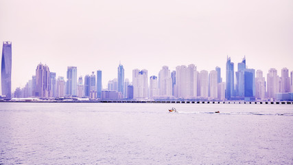 Panoramic picture of Dubai waterfront skyline, color toned picture, United Arab Emirates.