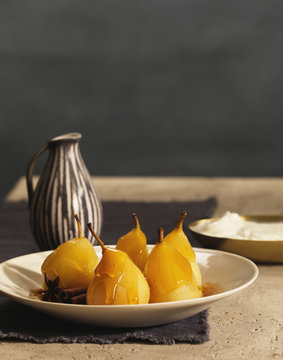 Glazed poached pears with cinnamon and star anise