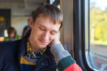 Young Man sit in the Train by the Window
