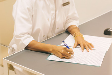 Close Up of Female Doctor Taking Notes
