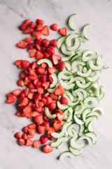 Raw strawberries and cucumbers for a refreshing vegan summer salad.