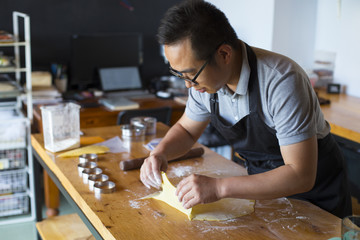 Asian baker working in the kitchen