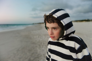 Boy at the beach after sunset