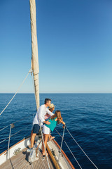 Family enjoying a summer day on a sailboat.