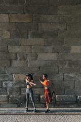 Women warming up at wall