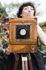 young woman shooting with large format camera