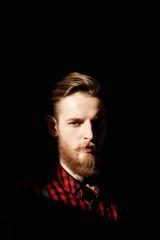 Pensive bearded man in the dark