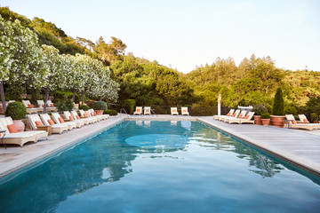 Pool and loungers at luxury resort and spa