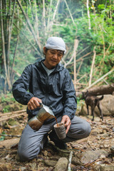 Asian man with coffee in the wild