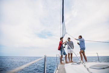 Group of Men Having Fun Time on Sailing Boat