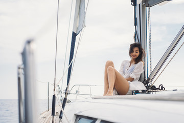 Woman Enjoying Summertime on Sailboat