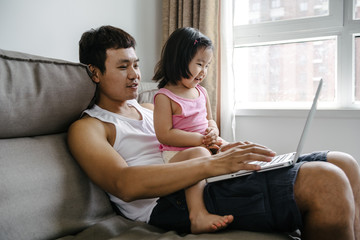 Adorable girl and her father at home