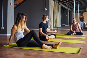 Group of people practicing yoga in yoga studio