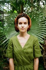 Elegant woman on green