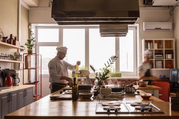 Chef making pasta on kitchen