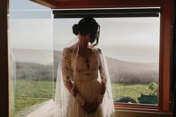 A Bride Standing by a Modern Window