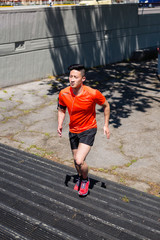 Young Chinese Man Exercising in the City