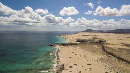 aerial view of road, desert, coast