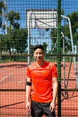 Asian Athlete Posing for Portrait Outdoors