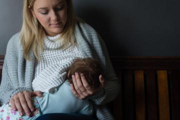 young mum nursing her newborn baby
