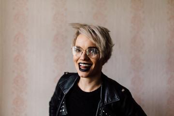 Portrait of shorthair blonde woman indoors
