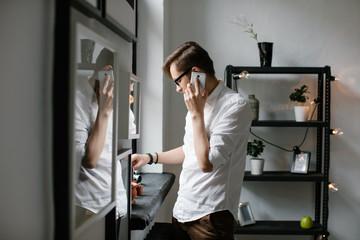 Man talking phone inside