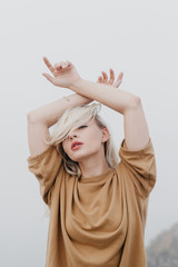 Elegant sensual model with hands up