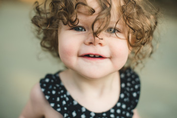 Close-up of smiling little girl