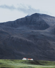 Isolated Houses in Iceland Amongst Mountains
