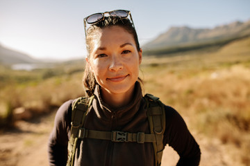 Portrait of young asian female hiker with backpack