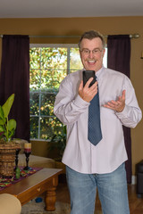 Mature male laughing during phone video call