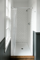 modern bathroom with walls painted half black and half white