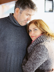 Charming mature couple embracing