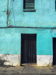 Blue painted old building