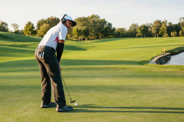 man putting while listening to music to stay focused