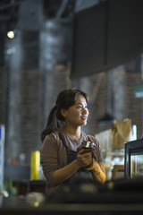 One young asian woman making caffee in the cafe
