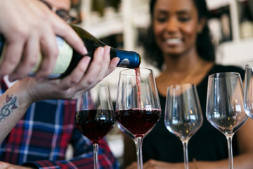 Wine: Shop Owner Pours Sample Of Red Wine For Customers