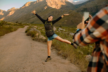 Excited female hiker posing for photograph