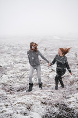 Two young joyful women travelling in iceland