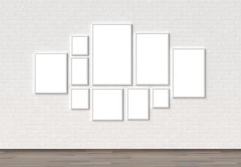 Empty Frame mock ups on white brick wall. 3D illustrating.