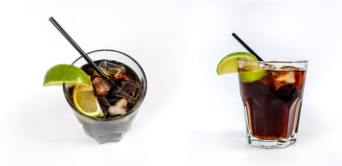 Alcoholic cocktail: Rum and cola  with ice cubes, lime
