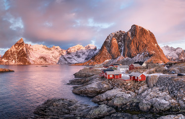 Foto op Plexiglas Poolcirkel Houses in the Lofoten islands bay. Natural landscape during sunrise