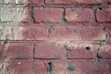 Dark red color plaster on old brick wall, grunge texture background