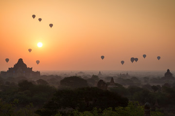Beautiful view of many hot-air balloons over temples and pagodas at the plain of Bagan in Myanmar (Burma) at sunrise.