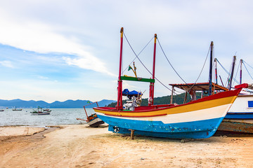 Colorful wooden fishing boat at the beach in Porto Belo.