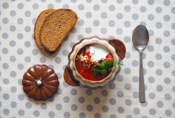 Vegetable soup with beetroot in a clay pot. Natural healthy food. Soup borscht with beet Russian and Ukrainian cuisine.