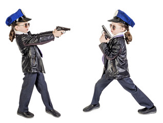 Boy in a tie and policeman's cap holding a gun in his hands, isolated on a white background