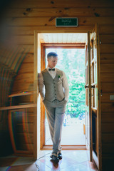 Handsome groom at wedding tuxedo waiting for bride. Rich groom at wedding day